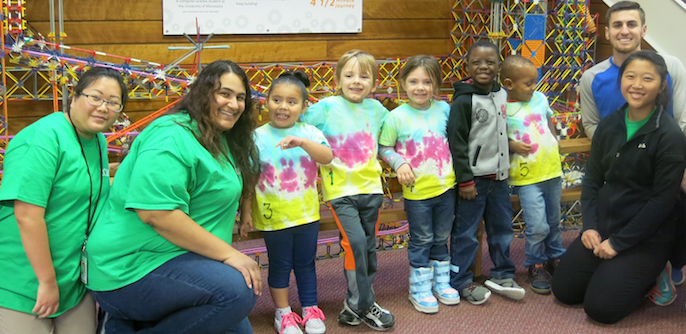 volunteers and children on a field trip