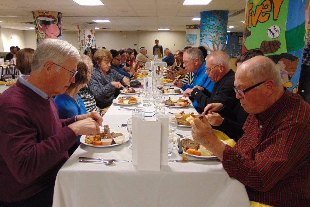 Volunteer Dinner guests dining at tables