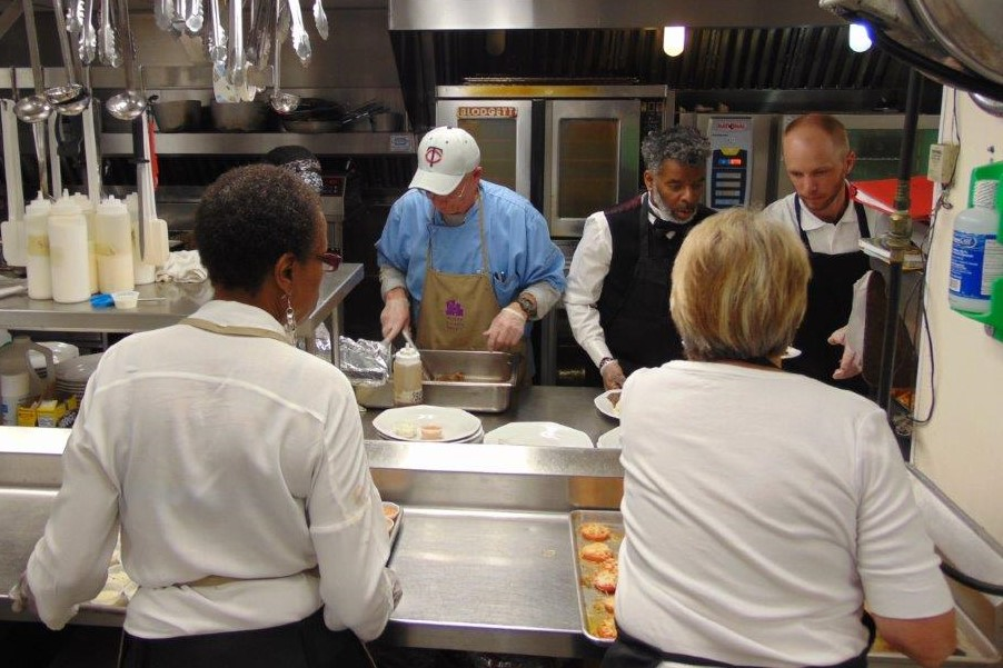 Staff preparing food in the kitchen for the Volunteer Dinner