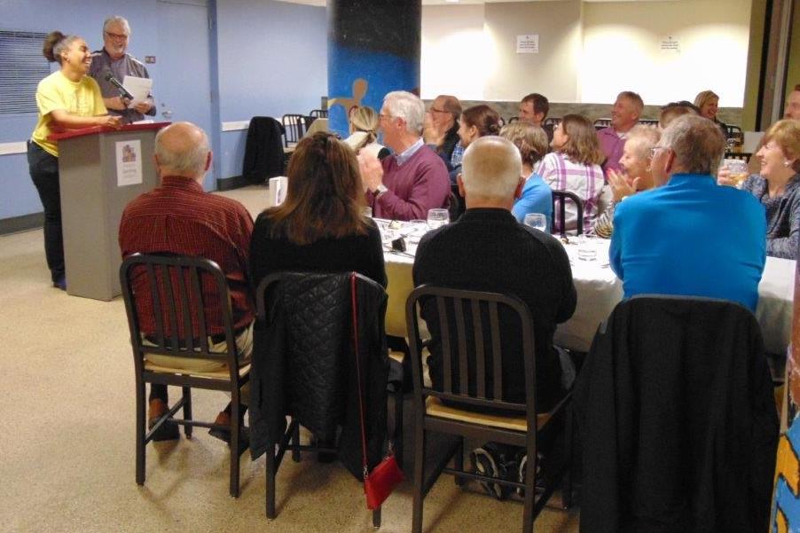 Volunteer Dinner guests listening to the presentation