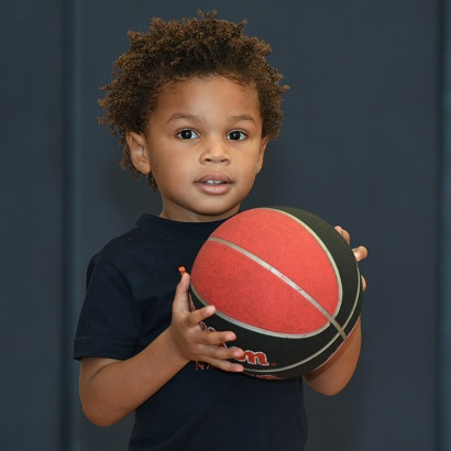 close-up - preschool boy w basketball