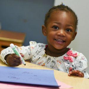 preschooler with marker & paper